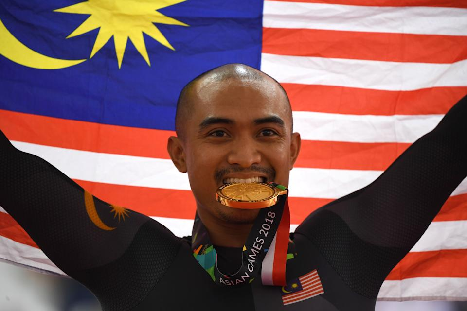 Gold medallist Malaysia's Mohd Azizulhasni Awang celebrates during the awards ceremony for the men's sprint event of the cycling track competition at the 2018 Asian Games in Jakarta on August 30, 2018. (PHOTO: AFP via Getty Images)