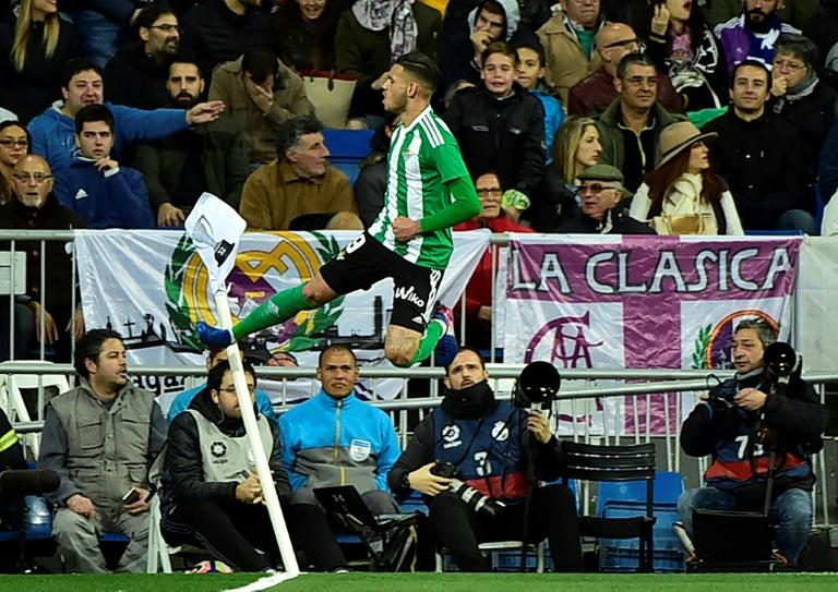 Betis' forward Antonio Sanabria celebrates a goal during the Spanish league footbal match Real Madrid CF vs Real Betis at the Santiago Bernabeu stadium in Madrid on March 12, 2017