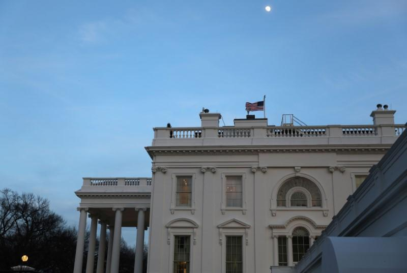 The White House is seen in at dusk in Washington