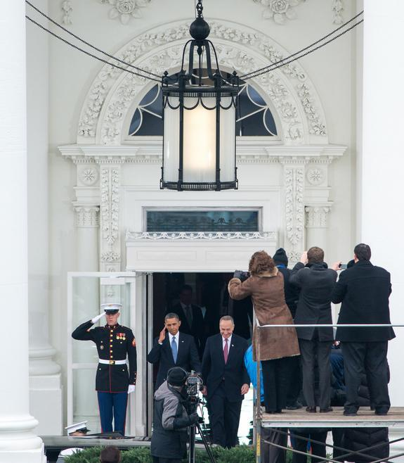 """President Barack Obama salutes as he and U.S. Senator Charles Ellis """"Chuck"""" Schumer (D-NY) depart the White House for Capitol Hill and the swearing-in of Obama as the nation's 44th President, Monday, Jan. 21, 2013, in Washington, DC."""