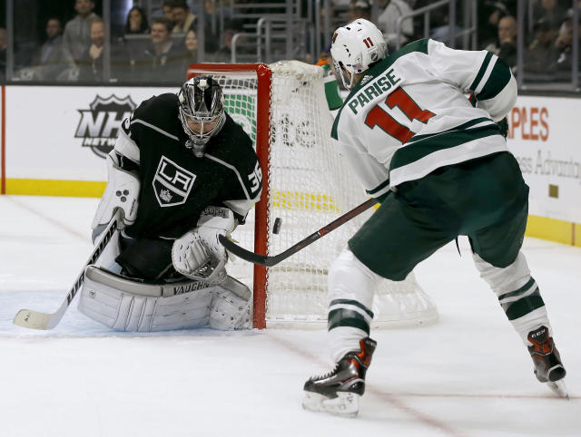 Los Angeles Kings goaltender Jack Campbell, left, deflects a shot by Minnesota Wild left wing Zach Parise during the first period of an NHL hockey game in Los Angeles, Thursday, Nov. 8, 2018. (AP Photo/Alex Gallardo)