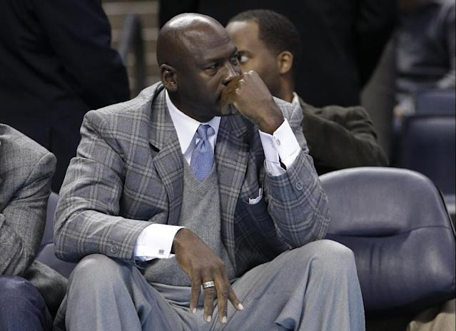 FILE - In this Jan. 23, 2013 file photo, Charlotte Bobcats owner Michael Jordan looks on from courtside during the second half of an NBA basketball game between the Charlotte Bobcats and the Atlanta Hawks in Charlotte, N.C. An Atlanta woman has filed a lawsuit saying basketball Hall of Famer and Charlotte Bobcats owner Michael Jordan is the father of her teenage son. The lawsuit was filed Feb. 6 by Pamela Smith in Fulton County Superior Court. (AP Photo/Chuck Burton, File)