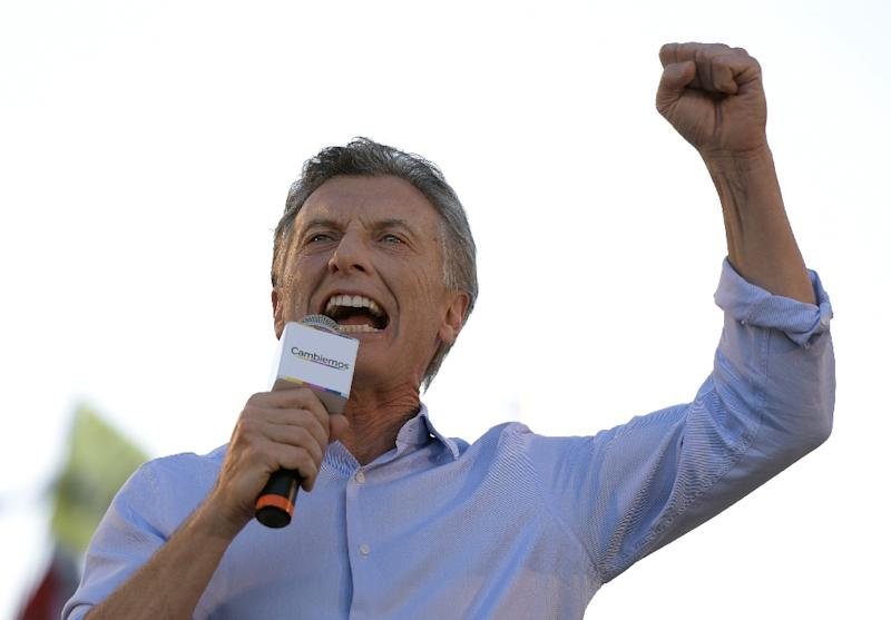 Mauricio Macri has cast himself as a force for change as many Argentinian voters are fed up after 12 years of rule by outgoing President Cristina Kirchner and her predecessor and late husband, Nestor Kirchner (AFP Photo/Juan Mabromata)