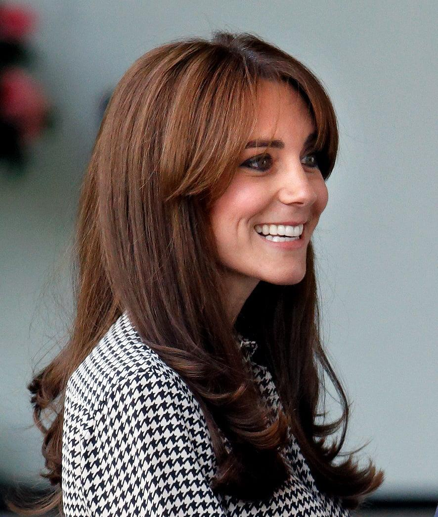 <p>The combination of long curtain bangs and long, straight layers gives us a '70s vibe that we're totally feeling for the duchess. </p>