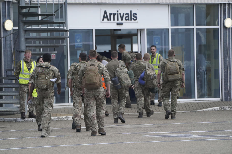 Members of the British armed forces 16 Air Assault Brigade walk to the air terminal after disembarking a plane from Afghanistan at RAF Brize Norton, in Oxfordshire, England, Sunday, Aug. 29, 2021. Military planes carrying British troops and diplomats from Kabul landed at a U.K. air base after the U.K.'s two-week evacuation operation ended. The U.K. ambassador to Afghanistan, Laurie Bristow, was among those who arrived Sunday at RAF Brize Norton northwest of London, hours after the government announced that all British personnel had left Kabul. (Jonathan Brady/Pool Photo via AP)