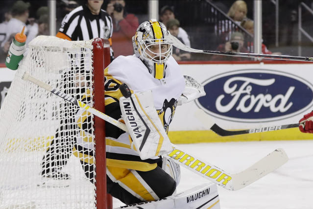 Pittsburgh Penguins goaltender Matt Murray (30) deflects a shot during the second period of the team's NHL hockey game against the New Jersey Devils on Friday, Nov. 15, 2019, in Newark, N.J. (AP Photo/Frank Franklin II)