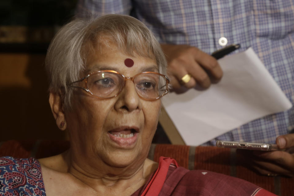 Nirmala Banerjee, mother of Abhijit Banerjee, interacts with media after Nobel Prize in economics was announced at her home in Kolkata, India, Monday, Oct. 14, 2019. The 2019 Nobel Prize in economics was awarded Monday to Abhijit Banerjee, Esther Duflo and Michael Kremer for pioneering new ways to alleviate global poverty. (AP Photo/Bikas Das)