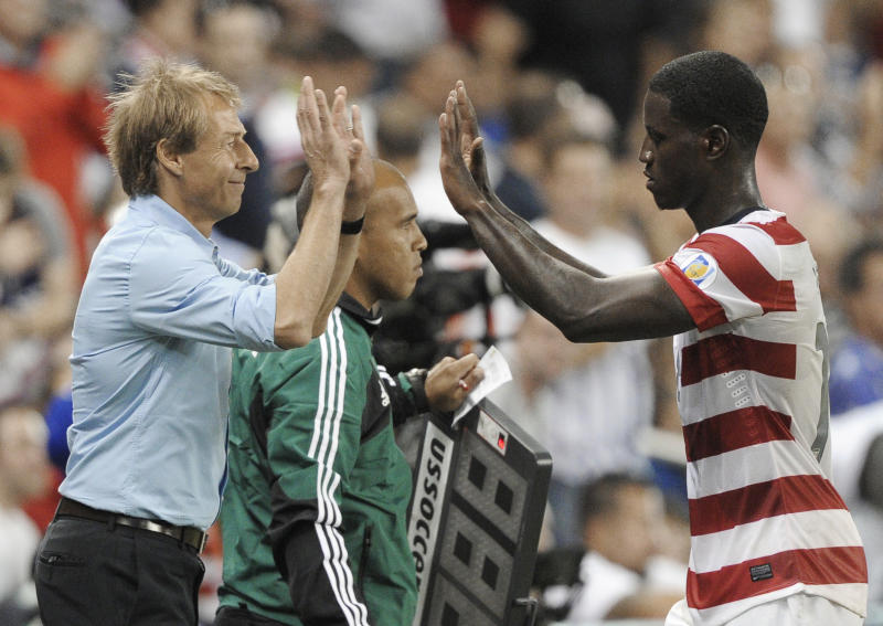 U.S. manager Jurgen Klinsmann greets forward Eddie Johnson as he comes out of the game late in the second half of a World Cup qualifying soccer match against Guatemala in Kansas City, Kan., Tuesday, Oct. 16, 2012. The United States won 3-1. (AP Photo/Reed Hoffmann)