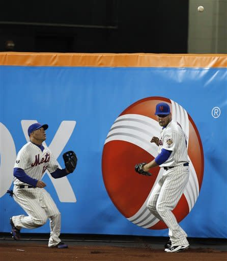 An RBI double by Washington Nationals' Wilson Ramos bounces above the head of New York Mets right fielder Lucas Duda, who can't locate it, as center fielder Scott Hairston comes in to assist Duda during the sixth inning of a baseball game in New York, Tuesday, April 10, 2012. (AP Photo/Kathy Willens)