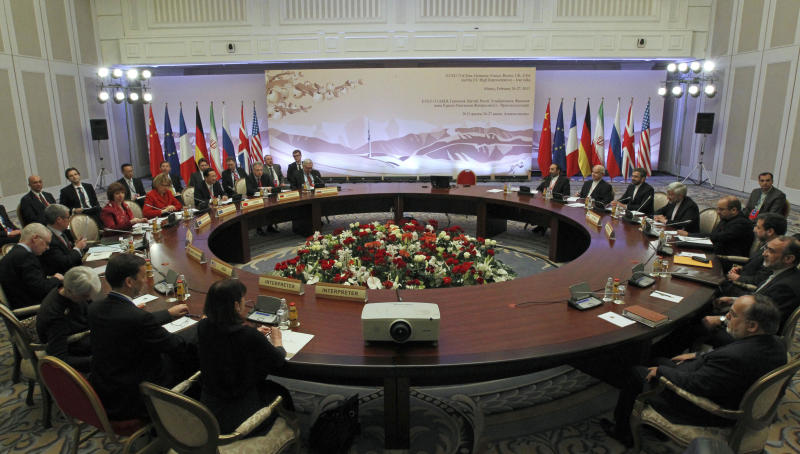 Diplomats participate in the fourth round of high-level talks with an Iranian delegation, right, aimed at stopping the Islamic regime's nuclear program from making atomic weapons despite widespread doubts that the stepping-stone meeting will yield a final deal in Almaty, Kazakhstan Wednesday, Feb. 27, 2013. World powers hope Iran will respond positively on Wednesday to their new offer to lift some sanctions if Tehran scales back nuclear activity the West fears could be used to build bombs. (AP Photo/ Shamil Zhumatov, Pool)