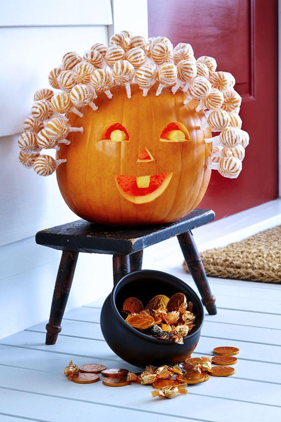 """<p>Have you seen a sweeter pumpkin? With orange and white <a href=""""https://www.amazon.com/Swipple-Petite-Swirl-Ripple-Lollipops/dp/B075G5Z5YN/ref=sr_1_4?tag=syn-yahoo-20&ascsubtag=%5Bartid%7C10055.g.23570028%5Bsrc%7Cyahoo-us"""" rel=""""nofollow noopener"""" target=""""_blank"""" data-ylk=""""slk:lollipops"""" class=""""link rapid-noclick-resp"""">lollipops</a> making up the """"hair,"""" most of the design is done. It's minimal carving and maximal fun. <br></p><p><a class=""""link rapid-noclick-resp"""" href=""""https://www.amazon.com/Swipple-Petite-Swirl-Ripple-Lollipops/dp/B075G5Z5YN/ref=sr_1_4?tag=syn-yahoo-20&ascsubtag=%5Bartid%7C10055.g.23570028%5Bsrc%7Cyahoo-us"""" rel=""""nofollow noopener"""" target=""""_blank"""" data-ylk=""""slk:SHOP LOLLIPOPS"""">SHOP LOLLIPOPS</a> </p>"""