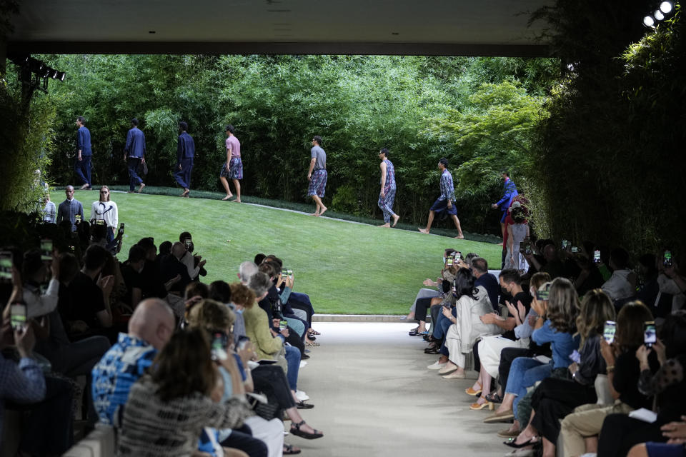 Models wear creations as part of the Giorgio Armani men's Spring Summer 2022 collection, in Milan, Italy, Monday, June 21, 2021. (AP Photo/Luca Bruno)
