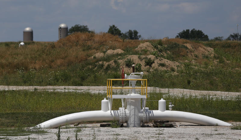 A valve extends above ground at the Enbridge Key Terminal near Salisbury, Mo., Tuesday, July 16, 2013. The company hopes to begin construction of the Flanagan South pipeline in early August. (AP Photo/Orlin Wagner)