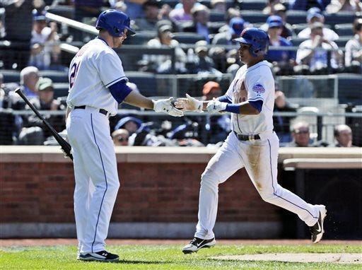 New York Mets' Ruben Tejada, right, is greeted by Lucas Duda after scoring on a David Wright's sacrifice fly during the sixth inning of the baseball game against the Los Angeles Dodgers at Citi Field Thursday, April 25, 2013, in New York. (AP Photo/Seth Wenig)