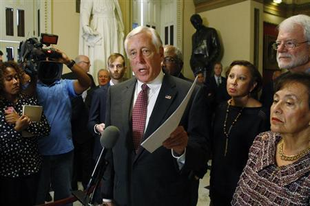 U.S. House Minority Whip Hoyer holds a copy of the Democratic legislation as he speaks to the media in Washington
