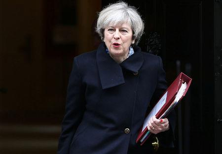 FILE PHOTO: Britain's Prime Minister Theresa May leaves Downing Street in London