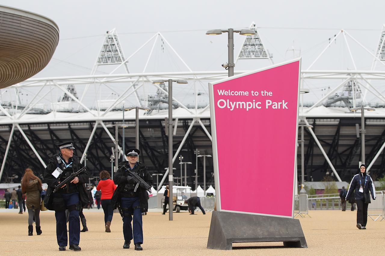 LONDON, ENGLAND - MAY 05:  Armed police officers patrol the Olympic Park during day two of the BUCS VISA Athletics Championships 2012 LOCOG Test Event for London 2012 at the Olympic Stadium on May 5, 2012 in London, England.  (Photo by Michael Steele/Getty Images)