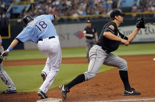 Tampa Bay Rays' Ben Zobrist, left, beats the throw to first base ahead of Miami Marlins first baseman Gaby Sanchez during the third inning of an interleague baseball game on Sunday, June 17, 2012, in St. Petersburg, Fla. (AP Photo/Brian Blanco)