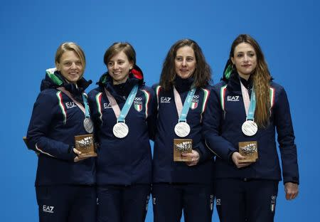 Medals Ceremony - Short Track Speed Skating Events - Pyeongchang 2018 Winter Olympics - Women's 3000 m - Medals Plaza - Pyeongchang, South Korea - February 21, 2018 - Silver medalists Arianna Fontana, Lucia Peretti, Cecilia Maffei and Martina Valcepina of Italy on the podium. REUTERS/Kim Hong-Ji