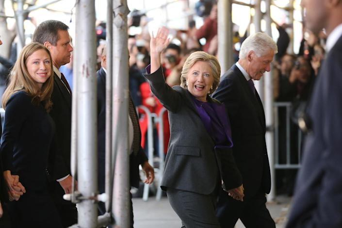 <p>Hillary Clinton, holding hands with her husband, former President Bill Clinton, waves to a crowd outside a New York hotel as she arrives to speak to her staff and supporters after losing the race for the White House, Wednesday, Nov. 9, 2016. At left is their daughter, Chelsea Clinton. Earlier in the day she conceded the race to Republican president-elect Donald Trump. (AP Photo/Seth Wenig) </p>