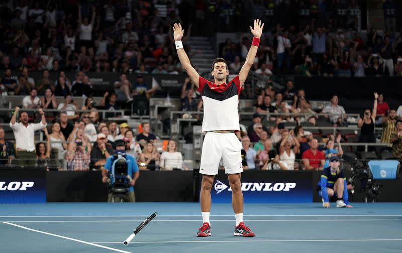 Novak Djokovic of Serbia reacts after winning his singles match against Kevin Anderson of South Africa on day 2 of the ATP Cup tennis tournament at Pat Rafter Arena in Brisbane