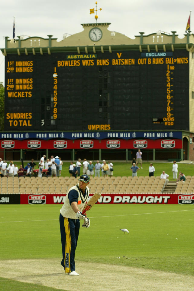 ADELAIDE - NOVEMBER 20:  Matthew Hayden of Australia checks out the Adelaide Oval wicket during the Australian training session ahead of the second Ashes Test match between Australia and England to be held at The Adelaide Oval in Adelade, Australia on November 20, 2002. (Photo by Nick Wilson/Getty Images)