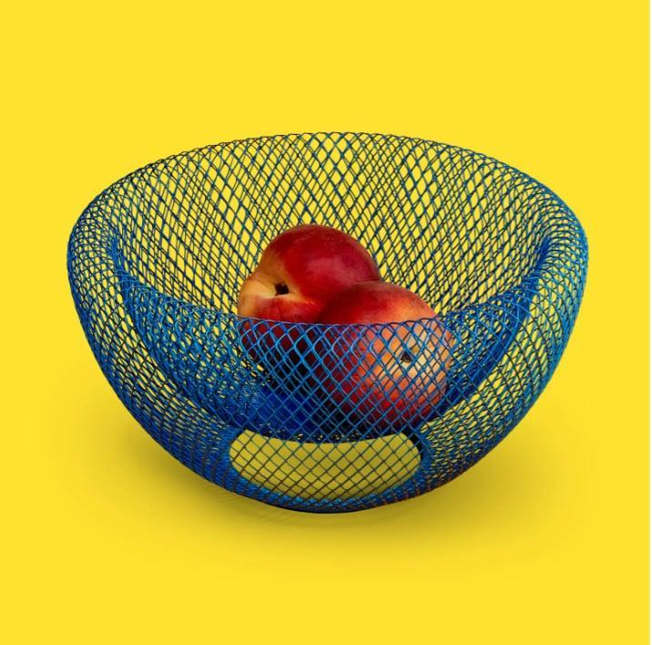<p>The kitchen might be one of the more practical rooms of the house, but it doesn't need to compromise style. Spice up your culinary corner with contemporary accessories, like this <span>Wire Mesh Bowl</span> ($50). (Psst . . . it's the perfect place to store your fresh produce.)</p>