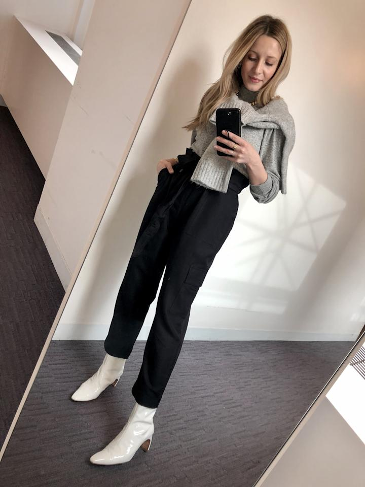 """<p>For my first utility-pant go, I re-created a look I double-tapped on the 'gram by one of my favorite fashion influencers, <a href=""""https://www.instagram.com/p/B62niu8FouM/"""" target=""""_blank"""" class=""""ga-track"""" data-ga-category=""""Related"""" data-ga-label=""""https://www.instagram.com/p/B62niu8FouM/"""" data-ga-action=""""In-Line Links"""">Pernille Teisbaek</a>. Tucking a thin gray mock-neck top into the high-rise pants, I tossed on a second sweater in a thicker fabric as an extracozy layer. Fun, yeah? To finish, I styled in white patent boots, a vintage gold necklace, and delicate rings and bracelets as the final touch.</p>"""