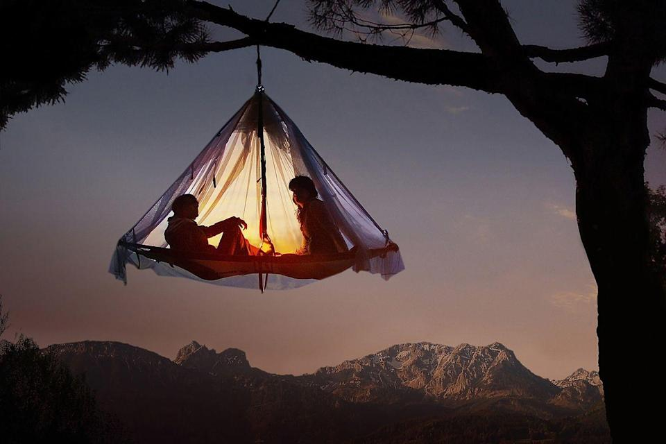 """<p>When you think of camping, you think of pitching a tent... on the ground. but <a href=""""https://www.waldseilgarten-hoellschlucht.de/english.html"""" rel=""""nofollow noopener"""" target=""""_blank"""" data-ylk=""""slk:Waldseilgarten Höllschlucht"""" class=""""link rapid-noclick-resp"""">Waldseilgarten Höllschlucht</a> is a much more unique take on that idea. Campers will try out tree camping, meaning you're staying in tents hung from tree branches high up in the forest canopy. Located in the German Alps, the stay offers unforgettable views fo the Pfronten mountains by the Austrian border, and an experience you'll never stop talking about. <br></p>"""