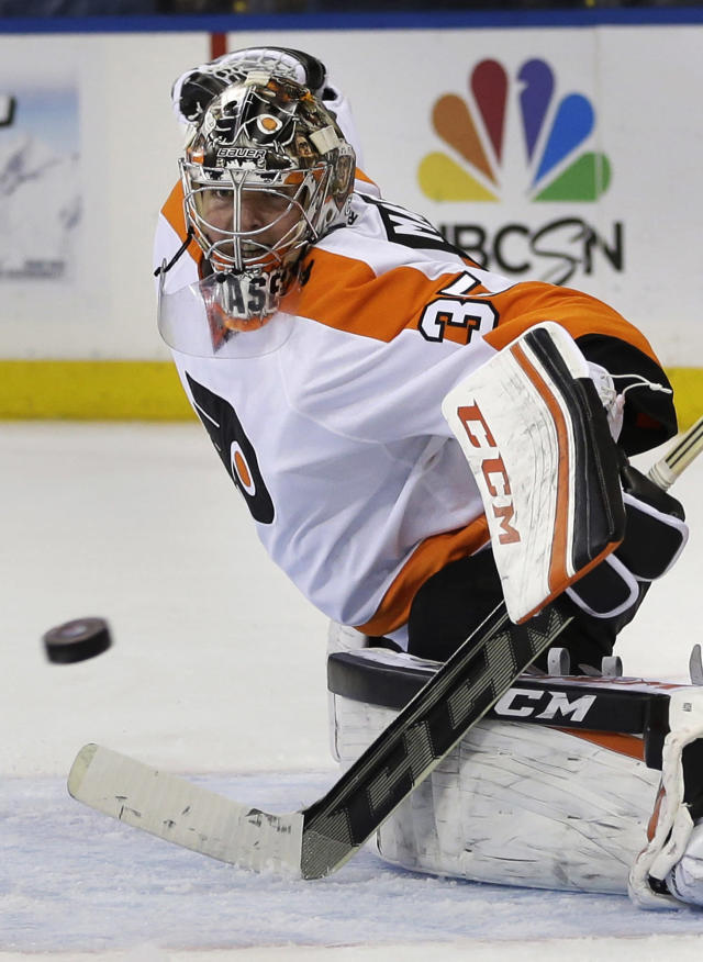 Philadelphia Flyers goalie Steve Mason watches the puck go past during the second period in Game 5 of an NHL hockey first-round playoff series against the New York Rangers, Sunday, April 27, 2014, in New York. The Rangers defeated the Flyers 4-2. (AP Photo/Seth Wenig)
