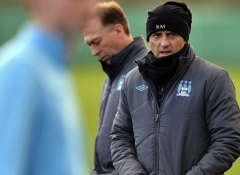 Manchester City manager Roberto Mancini (R) with his assistant David Platt in Manchester on December 3, 2012