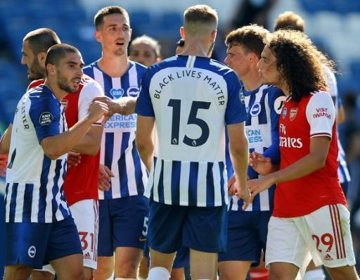 Arsenal and Brighton players clash at the end of their Premier League match
