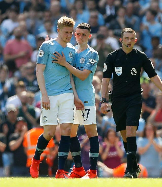 Phil Foden embraces team-mate Kevin De Bruyne