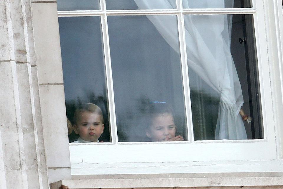 LONDON, ENGLAND - JUNE 08: Prince Louis and Princess Charlotte peer out of the windows of Buckingham Palace during Trooping The Colour, the Queen's annual birthday parade, on June 08, 2019 in London, England. (Photo by Chris Jackson/Getty Images)