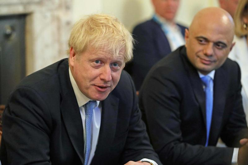 Prime Minister Boris Johnson and Sajid Javid at the first meeting of the new Cabinet (AFP/Getty Images)