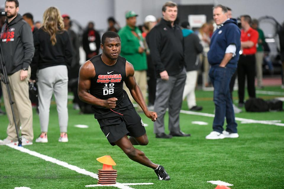 Cornerback Deandre Baker is watched by Georgia coach Kirby Smart and New England Patriots coach Bill Belichick during Georgia's pro day. (AP Photo)