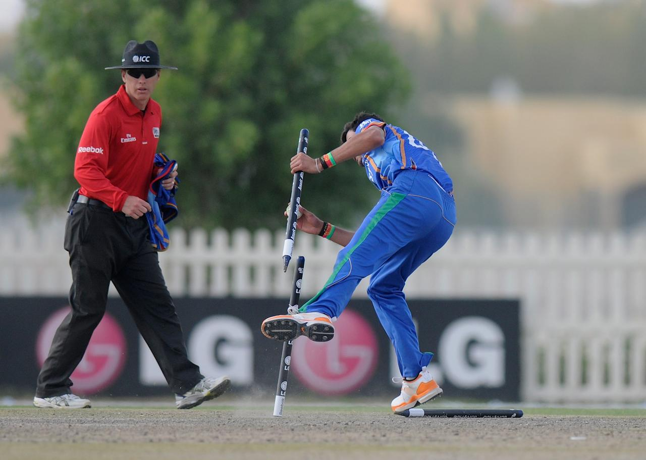 ABU DHABI, UNITED ARAB EMIRATES - FEBRUARY 17:  Abdullah Adil of Afghanistan gets the stump off to get Ben Ashkenazi of Australia run out during the  ICC U19 world cup match between Australia - U19 and Afghanistan - U19 played at the Sheikh Zayed Stadium Nursery 2  on February 17, 2014 in Abu Dhabi, United Arab Emirates.  (Photo by Pal Pillai-IDI/IDI via Getty Images)