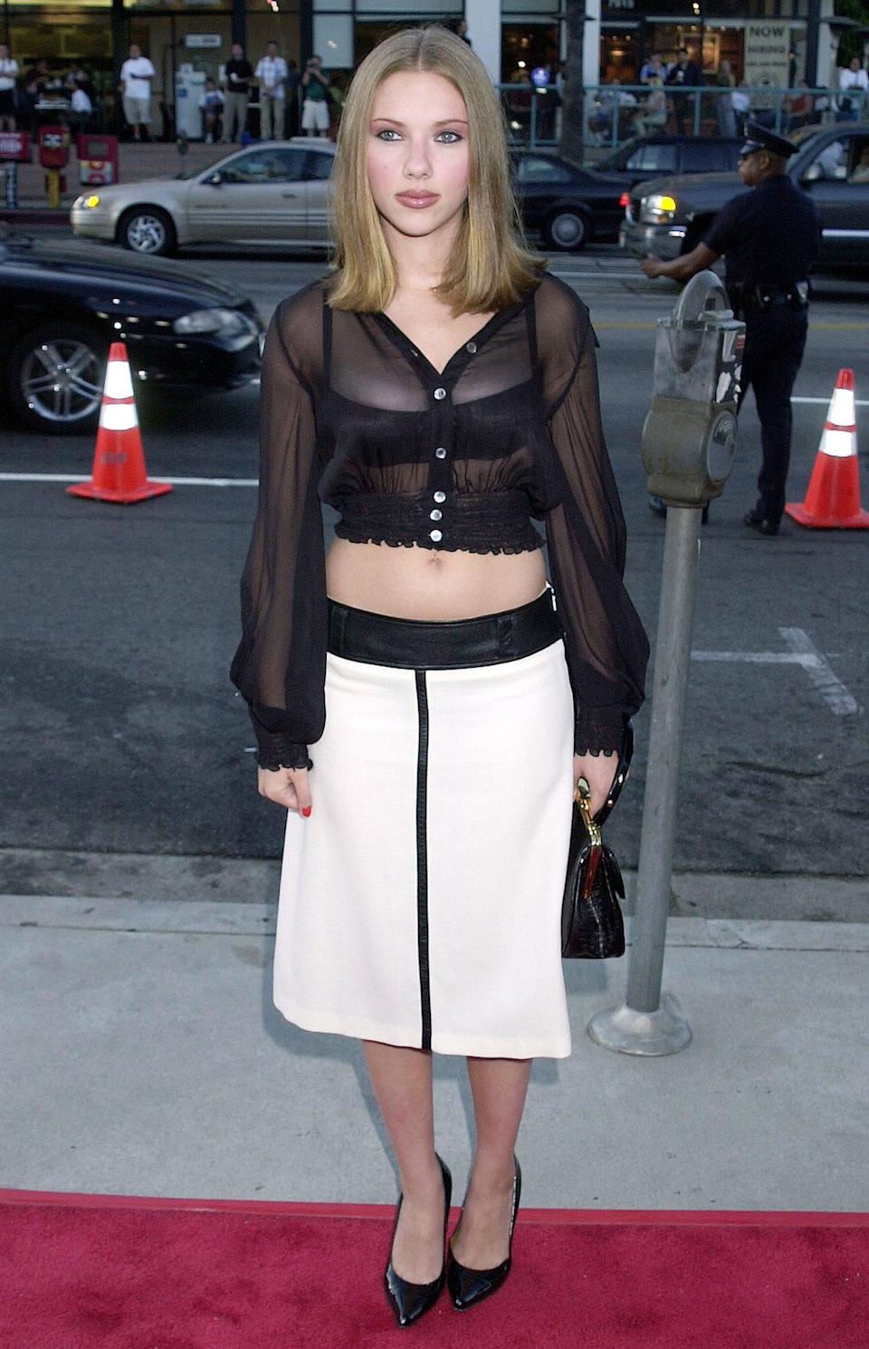 <p>The center-parted, shoulder-grazing hair! The umber-colored eye shadow that made her blue eyes pop! The crop top/pointy-toe shoe combo! The actress brought all the early-aughts trends to <em>The Others'</em> L.A. premiere in 2001.</p>