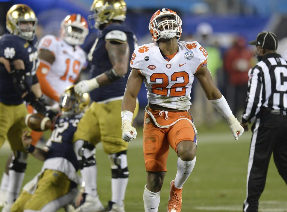 Clemson linebacker Trenton Simpson (22) celebrate after sacking Notre Dame quarterback Ian Book, back left, during the Atlantic Coast Conference championship NCAA college football game, Saturday, Dec. 19, 2020, in Charlotte, N.C. (Jeff Siner/The News & Observer via AP)