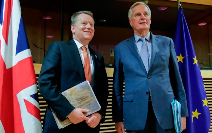 David Frost, the UK's chief negotiator, with Michel Barnier in Brussels in March. - Olivier Hoslet/AFP