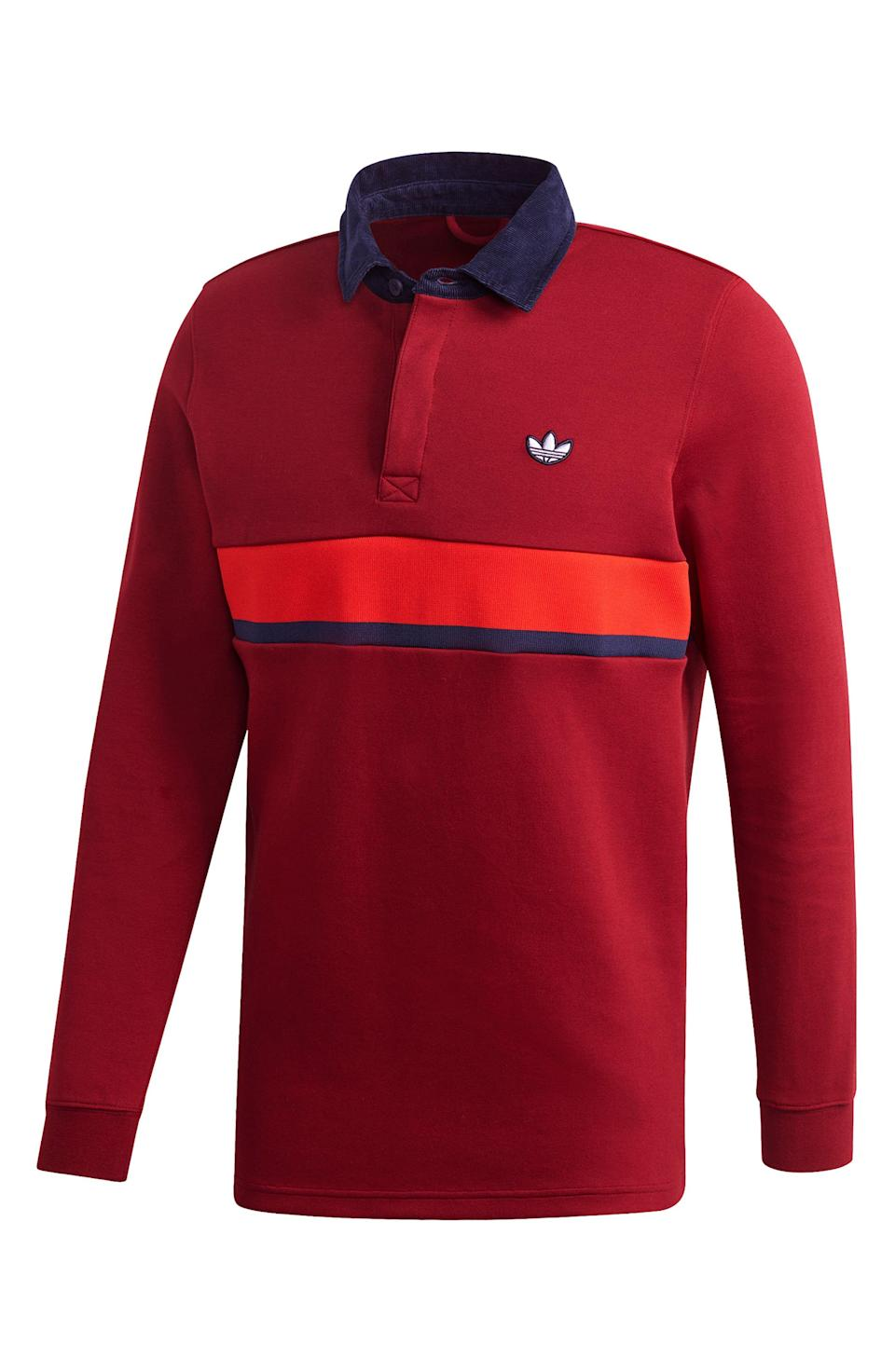 """<p><strong>ADIDAS ORIGINALS</strong></p><p>nordstrom.com</p><p><strong>$70.00</strong></p><p><a href=""""https://go.redirectingat.com?id=74968X1596630&url=https%3A%2F%2Fwww.nordstrom.com%2Fs%2Fadidas-originals-samstag-stripe-rugby-shirt%2F5515356&sref=https%3A%2F%2Fwww.esquire.com%2Fstyle%2Fmens-fashion%2Fg28074063%2Fbest-rugby-shirts%2F"""" rel=""""nofollow noopener"""" target=""""_blank"""" data-ylk=""""slk:Shop Now"""" class=""""link rapid-noclick-resp"""">Shop Now</a></p>"""