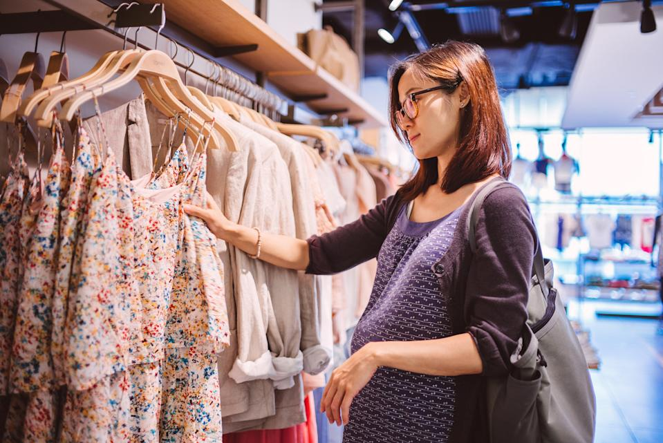 A new survey has revealed mums-to-be are forking out £700 on maternity wear [Photo: Getty]
