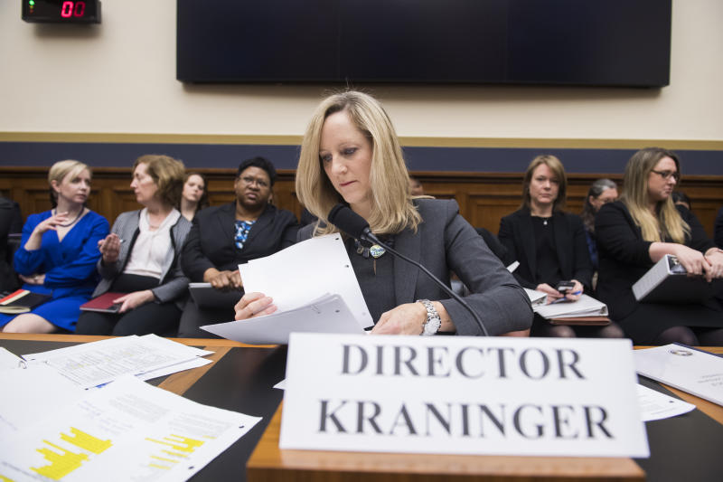 "UNITED STATES - MARCH 7: Kathy Kraninger, director of the Consumer Financial Protection Bureau, prepares to testify at a House Financial Services Committee hearing titled ""Putting Consumers First? A Semi-Annual Review of the Consumer Financial Protection Bureau,"" in Rayburn Building on Thursday, March 7, 2019. (Photo By Tom Williams/CQ Roll Call)"