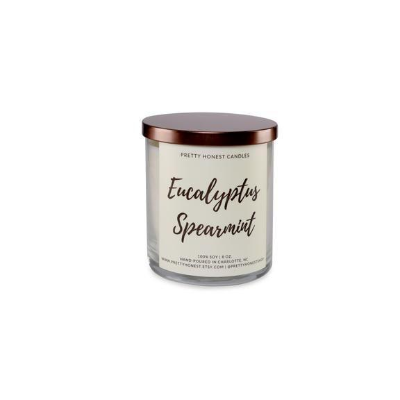 """<p><strong>Pretty Honest Shop</strong></p><p>prettyhonestshop.com</p><p><strong>$24.00</strong></p><p><a href=""""https://www.prettyhonestshop.com/collections/frontpage/products/eucalyptus-spearmint-soy-candle"""" rel=""""nofollow noopener"""" target=""""_blank"""" data-ylk=""""slk:Shop Now"""" class=""""link rapid-noclick-resp"""">Shop Now</a></p><p>A breath of fresh air in a candle is the perfect way to describe this eucalyptus-based scent.</p>"""
