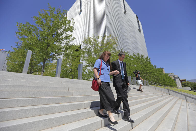 Mike and Becky Shamo, the parents of Aaron Shamo, walk from the federal courthouse Monday, Aug. 12, 2019, in Salt Lake City. Former Eagle Scout Aaron Shamo, 29, will stand trial on allegations that he and a small group of fellow millennials ran a multimillion-dollar empire from the basement of his suburban Salt Lake City home by trafficking hundreds of thousands of pills containing fentanyl, the potent synthetic opioid that has exacerbated the country's overdose epidemic in recent years. (AP Photo/Rick Bowmer)