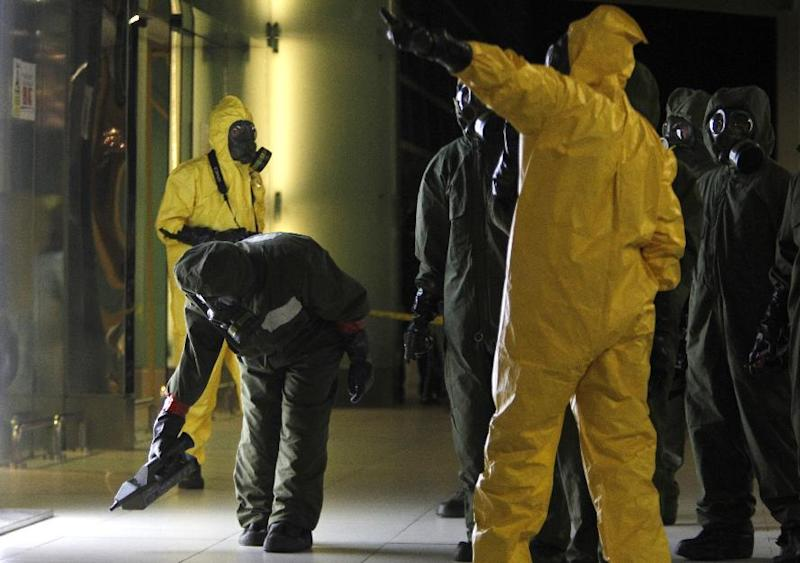 "A hazmat team member scans the decontamination zone at Kuala Lumpur International Airport 2 in Sepang, Malaysia Sunday, Feb. 26, 2017. Malaysia's health minister said Sunday that the dose of nerve agent given to North Korean ruler Kim Jong Un's half brother was so high that it killed him ""within 15-20 minutes."" A police official leading the investigations, said the terminal is ""free from any form of contamination of hazardous material"" and declared it a ""safe zone"" after a two-hour sweep. (AP Photo/Daniel Chan)"