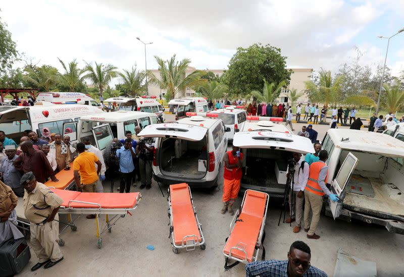 Somali paramedics stand next to their ambulances as a Turkish military cargo plane prepares to evacuate victims of the car bomb explosion at the Afgoye junction, for specialised treatment, at the Aden Abdulle International Airport in Mogadishu