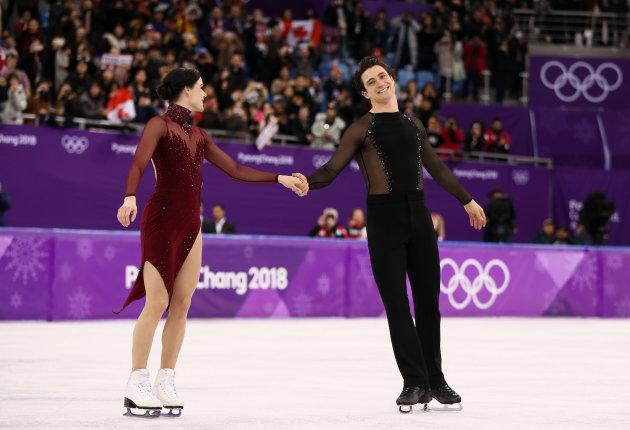 Gold medal winners Tessa Virtue and Scott Moir celebrate.