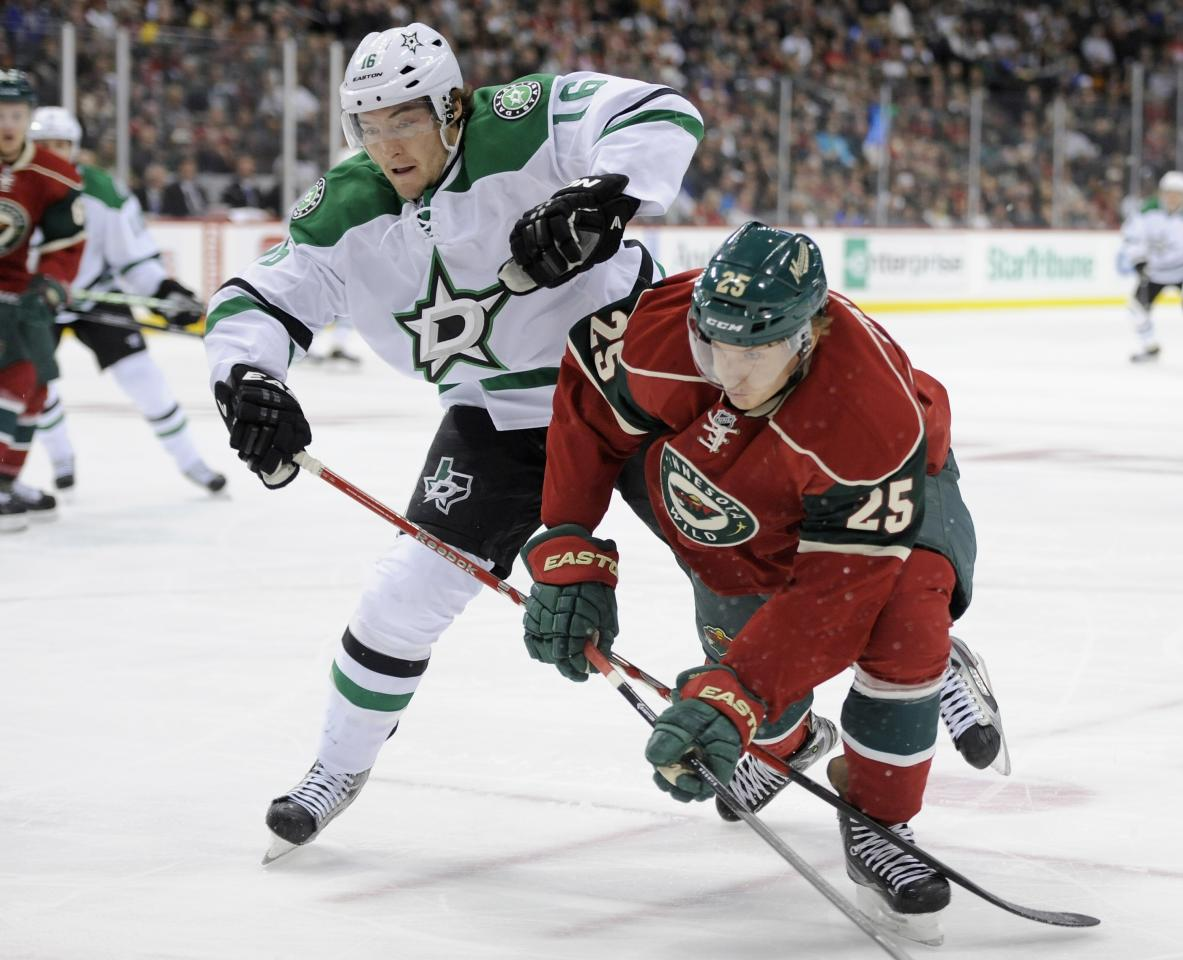 ST PAUL, MN - OCTOBER 12: Ryan Garbutt #16 of the Dallas Stars and Jonas Brodin #25 of the Minnesota Wild skate after the puck during the first period of the game on October 12, 2013 at Xcel Energy Center in St Paul, Minnesota. (Photo by Hannah Foslien/Getty Images)