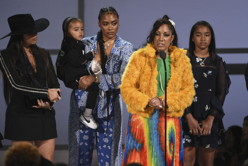 Angelique Smith, mother of late rapper Nipsey Hussle, accepts the humanitarian award on behalf of his son at the BET Awards on Sunday, June 23, 2019, at the Microsoft Theater in Los Angeles. Looking on from background left are Lauren London, Hussle's partner, son Kross, sister Samantha Smith, and daughter Emani Asghedom. (Photo by Chris Pizzello/Invision/AP)